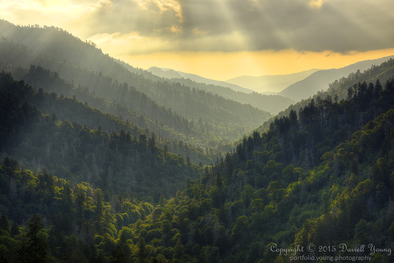 Near sunset at Morton's Overlook below Newfound Gap on the border of Tennessee and North Carolina. The suns rays light the mountain side with a beautiful warm glow.