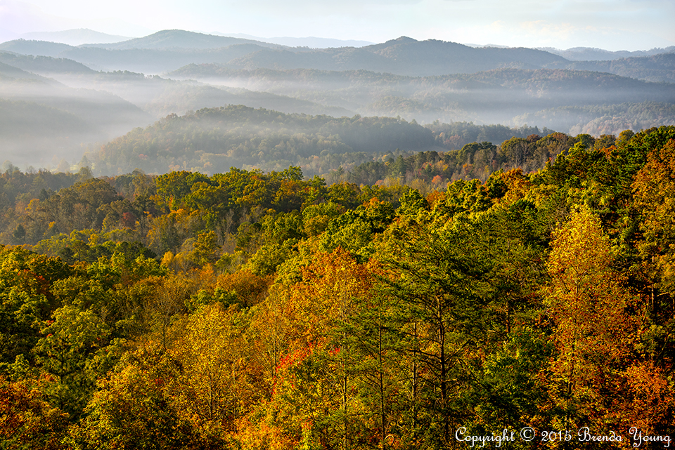 The sun rises over the mountains of Great Smoky Mountains National Park at the peak of autumn's colors. This is looking east into the Smoky mountains from the Foothills Parkway West. RAW to JPEG conversion.